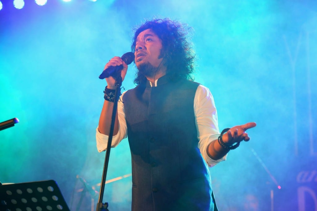 Papon performing on stage with Sennheiser