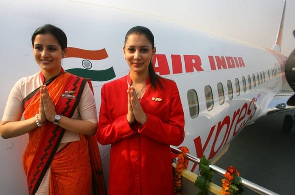 Air India air hostesses, wear their new uniform atop the Air India flight, during the delivery of the Boeing 737-800 Commercial Jetliner for Air India in New Delhi, 06 November 2006. Air India celebrated the delivery of the first of its planned order of 68 Boeing jetliners, the Boeing Next Generation 737-800 Commercial Jetliner, at the Indhira Gandhi International Airport.