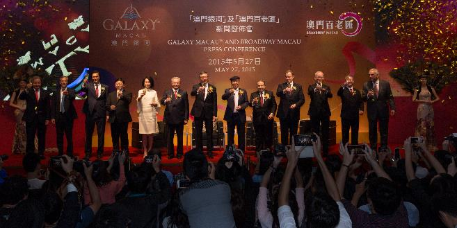 Simon Cooper, President and Managing Director Asia-Pacific of Marriott International, Inc. and Herve Humler, President and Chief Operating Officer of The Ritz-Carlton Hotel Company join the Galaxy senior management team on stage to toast the opening of the JW Marriott Hotel Macau and The Ritz-Carlton, Macau in the new Galaxy Macau™ Phase II.