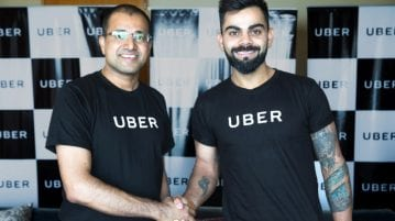 Amit Jain President Uber India SA with Uber India's Brand Ambassador Virat Kohli Captain Indian Cricket Team